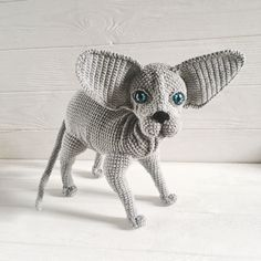 Crochet sphynx grey cat has all poseable paws and deep blue eyes and big ears.