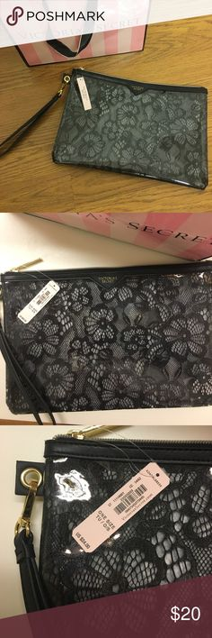 NWT Victoria's Secret Lace Clutch/ Wristlet Brand new Victoria's Secret clutch with wrist strap. Still has tissue paper inside- never been used! It is a clear plastic on the outside with black lace inside for a fun sexy look. Leather like strap and edging. Large size/ approximately 6'x10' but that's just an approximation since I don't have a measuring tool. See pics for size comparison to my hand. VS bag included!!  Victoria's Secret Bags Clutches & Wristlets