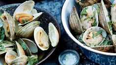 Grilled Clams with Aleppo Pepper, Tumeric, and Lime Butter - When you toss hot clams right off the grill with some flavored butter, the butter melts and mingles with the clam liquor, creating an irresistible combination. Clam Recipes, Chorizo Recipes, Fish Recipes, Vegetable Recipes, Seafood Recipes, Oyster Recipes, Seafood Meals, Grilling Recipes, Cooking Recipes
