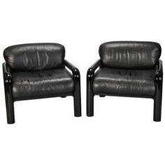 Pair Gae Aulenti for Knoll International Black Leather Arm Chairs | From a unique collection of antique and modern armchairs at https://www.1stdibs.com/furniture/seating/armchairs/