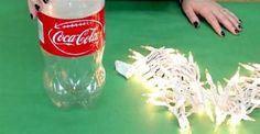 With Just A Coke Bottle And Some Christmas Lights, She Makes The Perfect Holiday Craft!