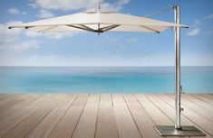 """""""Art and engineering harmonizing in a symphony of shade"""". TUUCI SINGLE CANTILEVER UMBRELLA. See more..."""