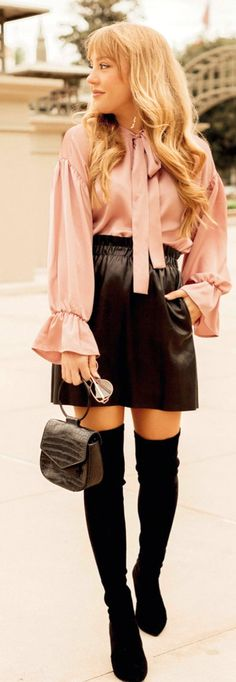 #spring #outfits woman wearing pink dress shirt and black skirt holding black hand bag. Pic by @hannahhagler