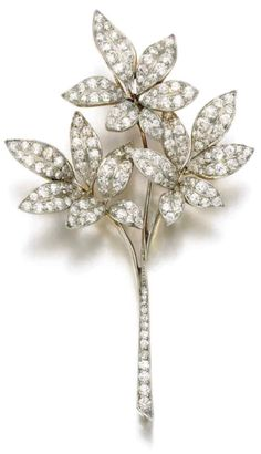 An antique diamond brooch, Tiffany & Co., early 20th century. Of foliate design, set with circular- and single-cut diamonds, signed Tiffany & Co. #Vintage #Tiffany #brooch