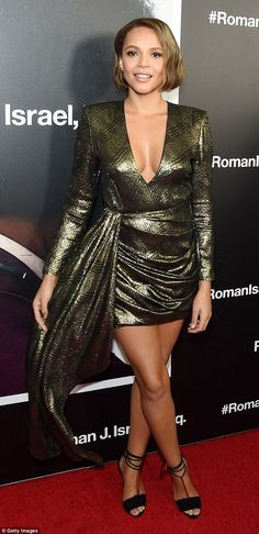Wow factor: Carmen, 44, fairly busted out of her very skimpy metallic wrap around mini dress with a thigh-skimming hem and a plunging neckline