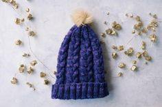 Whether youre just learning how to cable or have been cabling since before you can remember, the Purple Haze Knit Hat is a nice, easy cabled hat pattern that will suit anyone. Cable Knitting Patterns, Knitting Designs, Knit Patterns, Free Knitting, Knitting Projects, Sewing Patterns, Easy Knit Hat, Cable Knit Hat, Knitted Hats