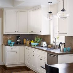 Cocoa-colored glass tiles melt into the quartz countertops for a seamless look. | Photo: Joe Schmelzer | thisoldhouse.com