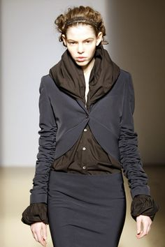 Description: A popular trend at the time for jackets was the cutaway style, obviously seen influencing this designers collection.