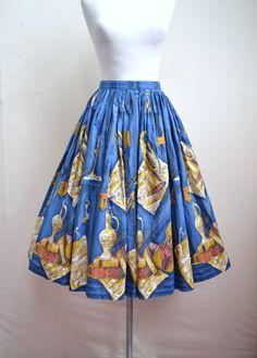 1950s Still Life print skirt ... with the blue background.  Much prettier, I think, than the brown.