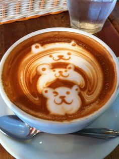 Hugging Bears - Espresso Yourself: 25 Pieces of Latte Art Worth Instagramming via Brit + Co.