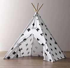 RH baby&child's Printed Canvas Black & White Teepee Tent:Printed with bold black-and-white graphics, our portable play tent features exposed wooden lodge poles like the iconic Native American teepee that inspired it. Perfectly proportioned to provide a cozy hideout for the littlest nomads, the scaled down size also makes it easy to assemble and store.