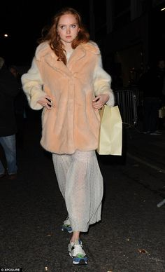 Popular choice: Model Lily Cole also left the party wearing one of the faux fur 'Wren' coa...