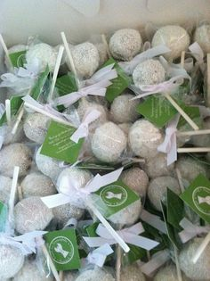 Golf ball cake pops wrapped in cellophane bags, tied with ribbon and a logo tag. Take-home party favors for golf tournament guests.