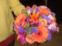 Hot pink purple orange and lime greed wedding bouquet.
