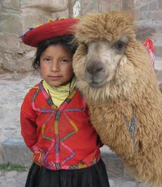 A lovely representative of the Quechua culture in Peru. This was taken at Cusco, and the pet is an alpaca. #Alpacas