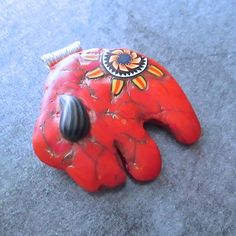 A personal favorite from my Etsy shop https://www.etsy.com/listing/233463966/faux-red-coral-buffalo-fetish-pendant