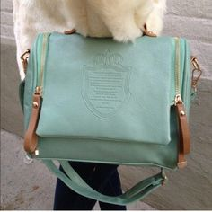 Green PU leather top handled/ cross body bag New. The strap is removable. The zipper pullers are green Bags Crossbody Bags