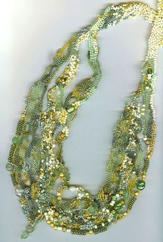 Beautiful freeform peyote necklace in just the colours I love in spring greens.