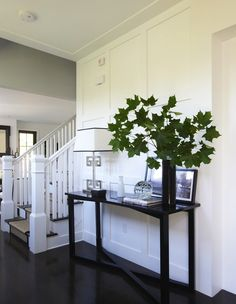 Suzie: Lynn Morgan Design - Gorgeous, elegant foyer design with glossy black console table, ...