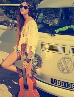 A hippie chick with a guitar and a VW bus... a classic