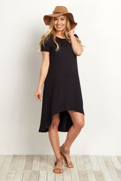 The perfect basic piece to style year round is finally here! This solid maternity dress features a trendy hi-low hemline and short sleeves to keep you cool and in style for every season. Dress this piece up with a statement necklace and wedges or boots for a complete ensemble.