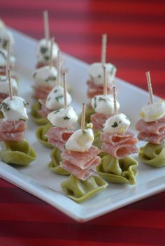 Mozzarella pearls are marinated in olive oil & herbs then stacked with salami & . Mozzarella pearls are marinated in olive oil & herbs then stacked with salami & cheese tortellini for an Easy Marinated Mozzarella and Tortellini Appetizer Phyllo Appetizers, Salami Appetizer, One Bite Appetizers, Wedding Appetizers, Yummy Appetizers, Appetizer Recipes, Italian Appetizers, Best Appetizers Ever, Toothpick Appetizers