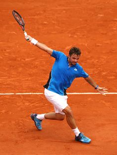 Stan Wawrinka of Switzerland plays a backhand during the mens singles first round match against Guillermo Garcia-Lopez of Spain during day two of the 2018 French Open at Roland Garros on May 2018 in Paris, France. Garcia Lopez, Stan Wawrinka, Tennis Photos, Match Point, French Open, First Round, Australian Open, Drawing Lessons, Tennis Racket