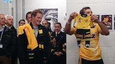 katemiddletons:  Wellington, New Zealand Trip, May 9, 2015-Prince Harry, with his own jersey over his shoulder, looks at the tiny jersey for Princess Charlotte held up by Hurricanes captain Conrad Smith.