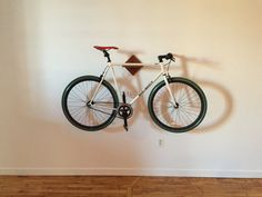 Great way to get your fixie or cruiser off the ground and show it off. Bike's top tube rests securely on a built in notch. Use the shelf space for