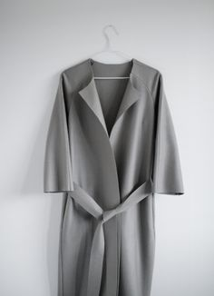 Chic Minimalist Tailoring - grey wool coat with crisp clean lines, understated style