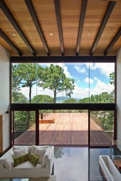 Living Room At The Mazamitla Forest House by Espacio Multicultural de Arquitectura Photography By Patricia Hernandez