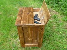 reused pallet nightstand with hidden weapon storage