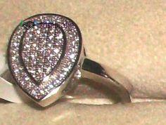 Anel em prata marca da Contrastaria novo c/pedras swarovski com marca da contrastaria. Totalmente em prata. Cravação micro-set a cristais swarovski. Medidas 13 16 19 ou 20. Preço de armazém....