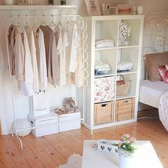 Pretty, girly room. Love the pastel colour scheme and the open wardrobe.