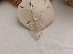 Wire Wrapped Sea Glass Heart pendant on sterling box chain by WaterSpirits Jewelry on Etsy.
