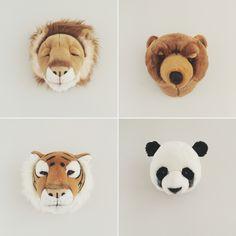 Trophées tête de lion tigre panda ours brun