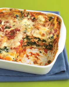 Spinach-and-Prosciutto Lasagna | Martha Stewart Living - Chopped bits of prosciutto add a savory, salty note to this no-fuss spinach lasagna while still keeping the meal light. Skim mozzarella and ricotta do their part as well.