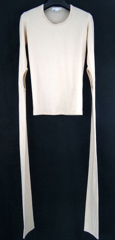 Helmut Lang elongated cut-out sleeve shirt from A/W 1998-1999. Made in Italy. 1998 was a very important year for Helmut Lang. The company relocated its offices from Vienna to Manhattan, making it the first fashion house to change continent, while the...