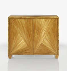 JEAN-MICHEL FRANK CABINET, VERS 1935 A STRAW MARQUETRY AND SYCAMORE CABINET BY JEAN-MICHEL FRANK, CIRCA 1935. STAMPED FOR THE DESIGNER, MONOGRAMMED CP FOR CHANAUX AND PELLETIER,