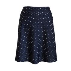 A-line travel skirt in navy polka dot print. Purple, lilac and white polka dots on a navy background.