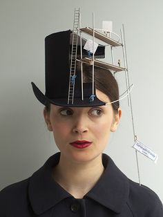 Construction Overhead is a hat that appears to be in the midst of construction, complete with scaffolding and tiny construction workers. The hat was created by London-based hatmaker Sorenson-Grundy.