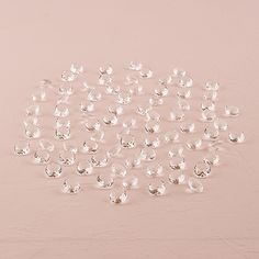 clear, decorative pebbles to go in bottom of centerpiece bowl - 240 pieces for $50 WEDDINGSHOP.THEKNOT.COM
