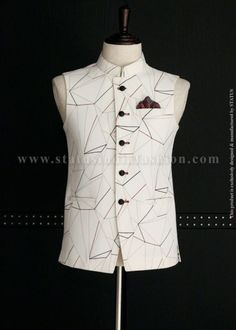 <p>This decent waistcoat in Snow White color is stitched from imported fabric and designed with contrasting line patterns. Crafted with a mandarin collar, welted waist pockets along with matching buttons and a complementing pocket square, this waistcoat will add to your personality and give you a sober yet dashing look.</p>