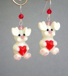 Bunny earrings with heart, floppy eared, lampwork glass. $17.00, via Etsy.