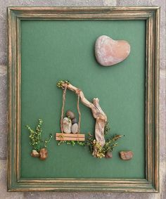 "Pebble Art (parent and child in a swing together in the outdoors) displayed in an 8x11 ""open"" reclaimed wood frame by CrawfordBunch on Etsy"