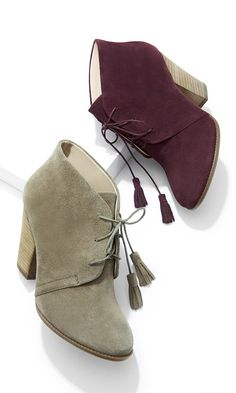 Suede lace-up ankle booties with fun tassels and stacked heels
