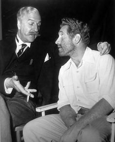 """Louis Calhern having a conversation with visitor, James Whitmore on the set of The Magnificent Yankee (1950). """""""