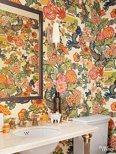 Imagine the surprise guests receive when they open the door to this powder room and see this unique modern Chinoiserie wallpaper. A small bath like this is the perfect place to go bold with a strong pattern. Paired with white fixtures and minimal accessories, the look is polished, not overbearing. Get it: Chiang Mai Dragon, F. Schumacher & Co.; fschumacher.com (to the trade).