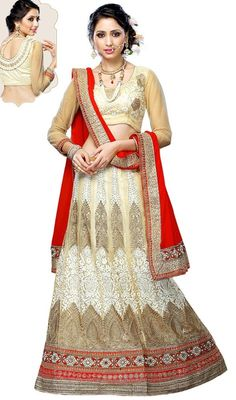 Savor the adulation that breeze your way adorned in this beige and cream color net embroidered lehenga cholie. The desirable lace, patch, resham and stones work a vital characteristic of this attire.  #traditionalwears #trendydesigncholi #womenlehengacholis