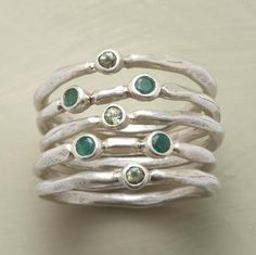 QUINTILLIA STACK RINGS -- Five slender brushed sterling silver bands handcrafted in flowing organic shapes are dotted with single peridots or double emeralds. Whole sizes 5 to Jewelry Art, Jewelry Rings, Jewelry Accessories, Jewelry Ideas, Gemstone Jewelry, Fashion Accessories, Handmade Rings, Handmade Jewelry, Unique Jewelry